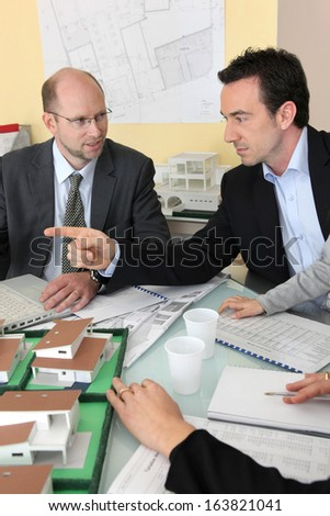 Architects in meeting - stock photo