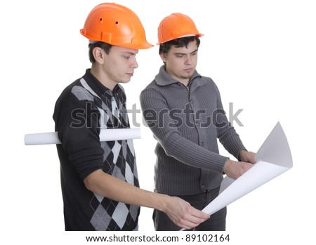 Architects looking on blueprints