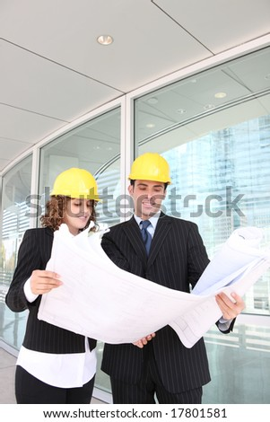 Architects on a building construction site - stock photo