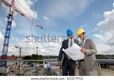 Architects on construction site - stock photo