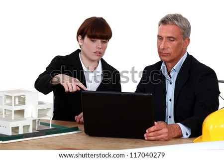 Architects with a laptop and 3D model