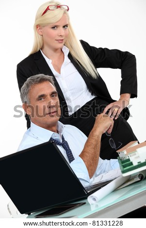 Architects with plans and 3D model - stock photo