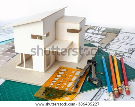 Architects workspace small house model drawing stock photo image architects workspace with small house model drawing sketch home renovation concept ccuart Gallery
