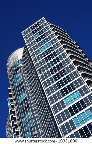 Architectural abstract of modern condo building fragment - stock photo