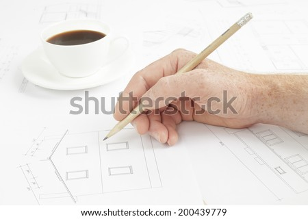 Architectural background. Human hand with pencil over blueprints with sketches of projects. - stock photo