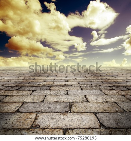 Architectural background with cobbled streets and sky - stock photo