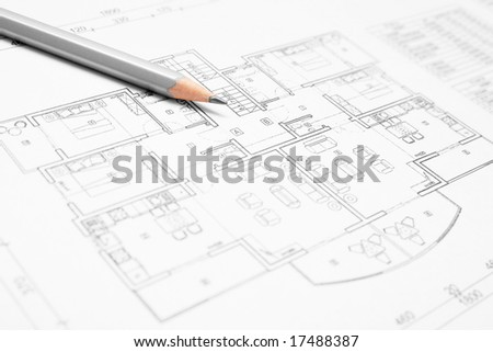 Architectural blueprint of house plan closeup with a pencil. - stock photo