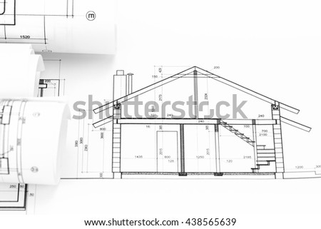 architectural blueprint rolls and home plan drawing - stock photo