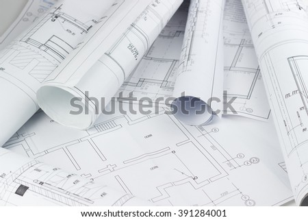 Architectural blueprints and blueprint rolls.