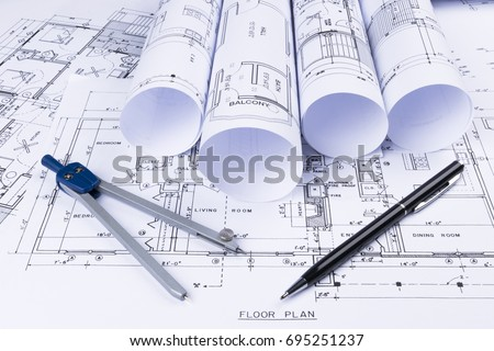 Architectural blueprints blueprint rolls drawing instruments stock architectural blueprints and blueprint rolls and a drawing instruments on the worktable drawing compass malvernweather Images