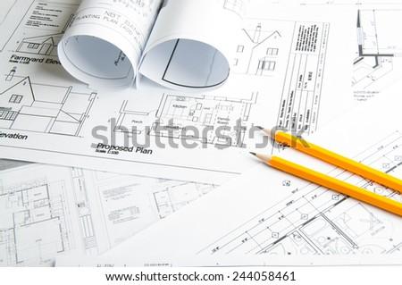 Fotos de stock de arquitectura imgenes de edificioslugares architectural blueprints and blueprint rolls and two yellow pencils malvernweather Image collections