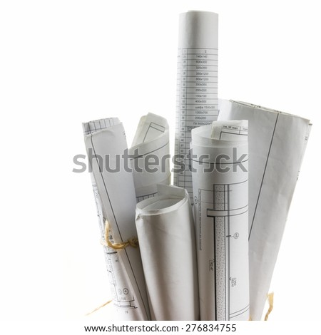 Architectural blueprints and blueprint rolls on white background. - stock photo