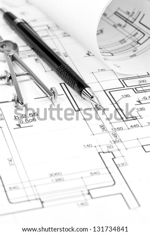 Architectural blueprints and drawing tools - stock photo