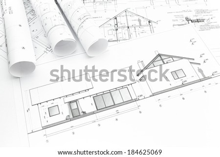 Architectural blueprints of new home and construction plans rolls - stock photo