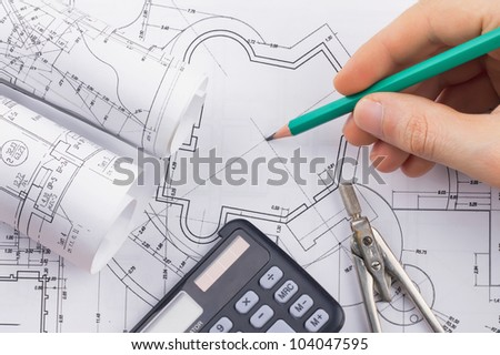 Architectural blueprints rolls and development of technology project - stock photo
