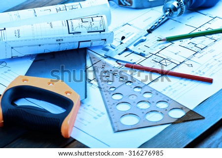 Architectural blueprints rolls and engineering items - stock photo