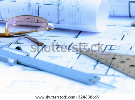 Architectural blueprints rolls and engineering items. Toned in blue - stock photo