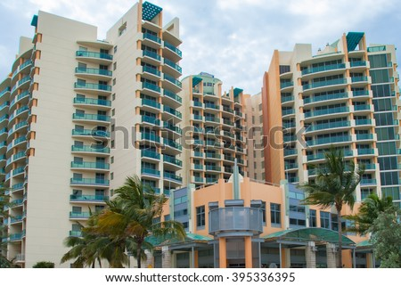 Architectural building for vacation rental in Miami Style Florida   Modern art deco residential building in vibrant colors with palm trees , image for architecture travel real estate business blog - stock photo