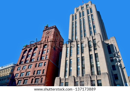 Architectural Buildings seen from the Place d'Armes in Old Montreal - stock photo