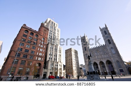 Architectural Buildings seen from the Place d'Armes in Old Montreal and Basilica of Notre-Dame.