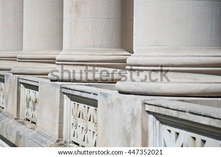 Architectural Columns on a Federal Courthouse for Lawyers seeking Justice - stock photo