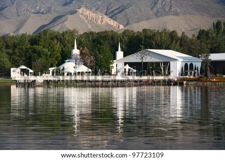 Architectural complex on  bank of mountain lake. Kyrgyzstan. Lake  issyk-kul.