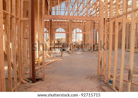 Architectural construction framework under bright blue sky - stock photo