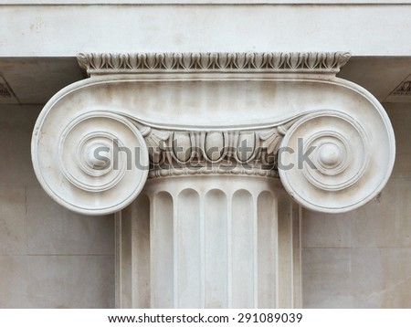 Architectural detail of an ancient Ionic capital - stock photo