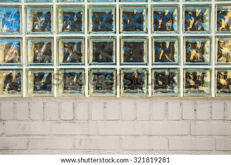 Architectural detail of building with privacy glass block window and bricks - stock photo