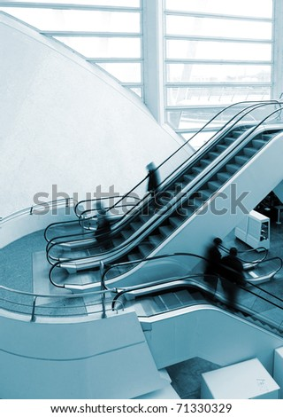 architectural detail of escalator and people