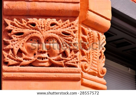 architectural detail of gargoyle carved from colorado-red stone on capital of 19th century building in aspen, colorado - stock photo