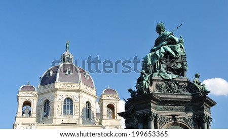 Architectural detail of Kunsthistorisches Museum dome and a statue representing the empress Maria Theresa - stock photo
