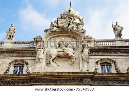Architectural detail of Lyon, France city hall, with Henry IV on a horse and other statues. - stock photo