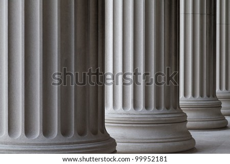 Architectural detail of Neoclassic columns in a row.