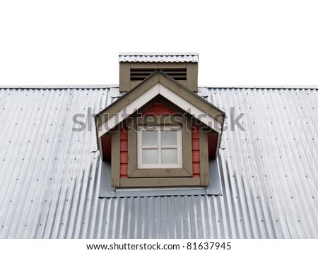 Architectural detail of small dormer window in metal sheet roof of residential house. - stock photo