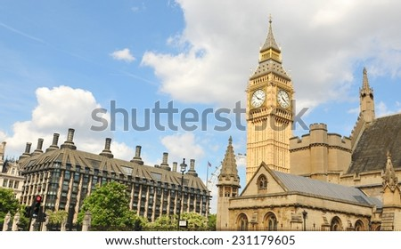 Architectural detail of the Big Ben behind the old building of the Houses of Parliament in London, UK.  - stock photo