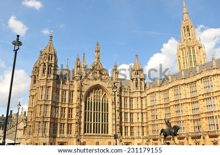 Architectural detail of the British Parliament building against blue sky  - stock photo