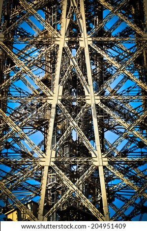 Architectural detail of the design of the Eiffel Tower in Paris, France - stock photo