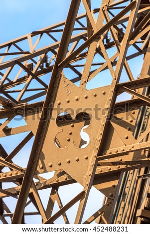 Architectural detail of the Eiffel Tower in Paris - stock photo