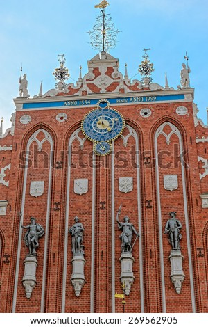 Architectural detail of the facade of House of the Brotherhood of Black Heads in Riga, Latvia. Blackheads house was built in 1334 and was repaired in 1991. - stock photo