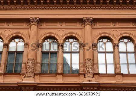 Architectural detail on the red Riga Bourse building housing an art museum