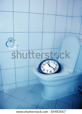 architectural detail shot of a house toilet and a clock - stock photo