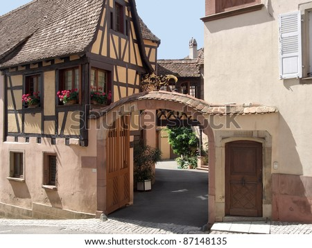 architectural detail with half-timbered house in Mittelbergheim, a village of a region in France named Alsace - stock photo
