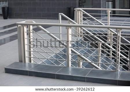 architectural details, modern stainless steel balustrade, and black marble floor - stock photo