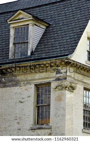 Architectural details of a Dutch Colonial building awaiting renovation.