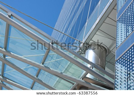 architectural details of a glass and steel office building - stock photo