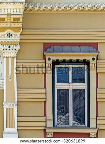 Architectural details of an old window at a historic building located in Union Square, Timisoara, Romania.