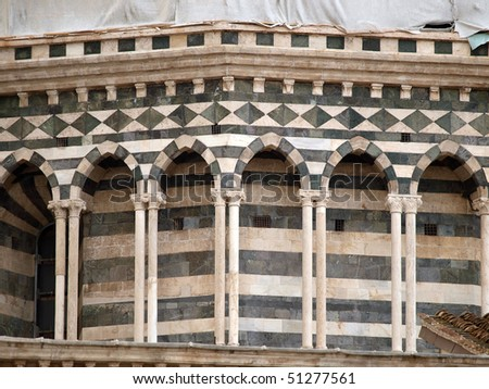 Architectural details of  cathedral in medieval town Siena,Tuscany,Italy. The Duomo of Siena, which was built in the 12th and 13th centuries, is one of the prettiest churches in Gothic style in Italy - stock photo