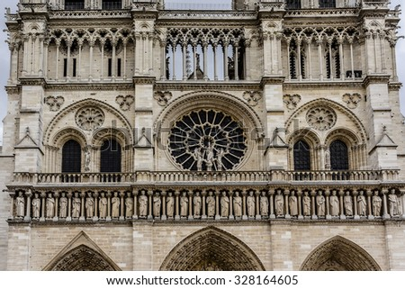 Architectural details of Cathedral Notre Dame de Paris. Cathedral Notre Dame de Paris - most famous Gothic, Roman Catholic cathedral (1163-1345) on the eastern half of the Cite Island. France, Europe. - stock photo