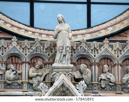 Architectural details of Duomo facade - Siena,Tuscany,Italy. The Duomo of Siena, which was built in the 12th and 13th centuries, is one of the prettiest churches in Gothic style in Italy - stock photo